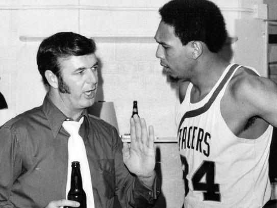 A locker room scene of yore:  Leonard, with cigarette