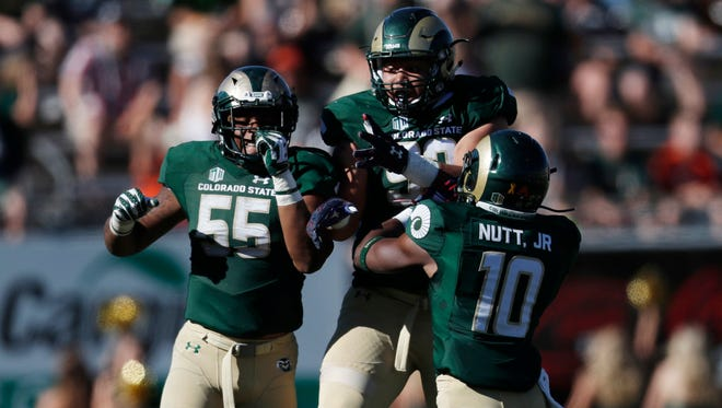 CSU defenders, from left, Josh Watson, josh Lovingood and Kevin Nutt celebrate a quarterback during Saturday's win over Texas-San Antonio at Hughes Stadium. Watson lost a spot in the starting lineup after a poor showing in the opening game, while Nutt moved into what has been a constantly changing lineup through the first two games of the season.