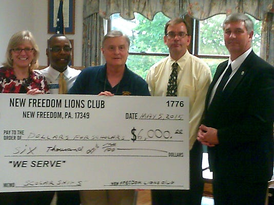 The New Freedom Lions Club recently presented $6,000 to the Southern York County School District Foundation for six scholarships to Susquehannock High School seniors to further their education. Involvement with community service, along with grades, plays a large part in qualifying for these scholarships. Pictured L/R-  Dr. Sandra Lemmon, Lion President Ron Gillis, Lion Treasurer Phil Olphin, Judge Jeff Joy, Dr Wayne McCullough.