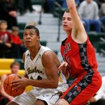 C.M. Russell's Karl Tucker II, left, eyes the basket as Bozeman's Adam Huse defends earlier this season at CMR Fieldhouse
