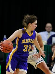 Bloomfield Hills Marian's Kara Holinski dribbles in the first half of the MHSAA Class A girls basketball final on Saturday, March 21, 2015 in East Lansing.