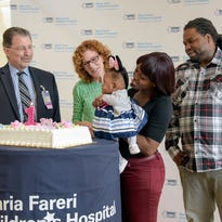 Dr. Edmund LaGamma,, chief of Newborn Medicine, Maria Fareri Children's Hospital; Sue Malfa, RN, Nurse Manager, Regional Neonatal Intensive Care Unit, Maria Fareri Children's Hospital; mother Dominique Fevrier; Tamaya Berry; and father Tyquan Berry celebrate Tamaya's first birthday.