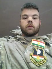 Ryan O'Leary has placed Kurdish patches on his old Iowa National Guard camouflage uniforms, which used to have U.S. insignia. He said he took this picture of himself in Kurdistan this week.