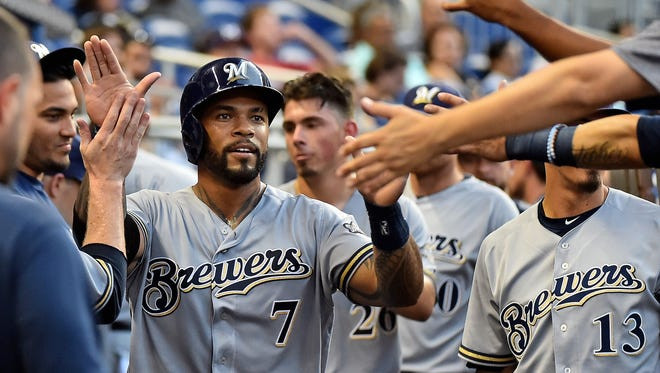 Brewers first baseman Eric Thames scores a run in the third inning.