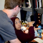 Jasmine Burks, a senior media and information major at MSU, talks with Sage Miller, a senior media and information major, as they figure how to design a bridge in a racing game they are designing Monday, July 13, 2016, at the Games for Entertainment and Learning Lab on campus.
