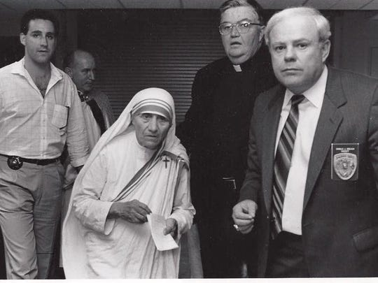 Tim Breaux, Mother Teresa, Father Brennan and Sheriff Don Breaux are pictured at the Cajundome during her visit to Lafayette.
