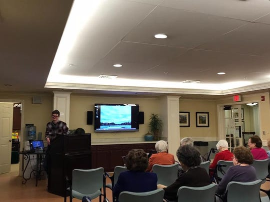 Eric Schubert, a Shawnee High School student, speaks to a group at Brightview Greentree, a retirement community in Marlton. He has a business called ES Genealogy, which helps people learn about their family history and in some cases connect with loved ones.