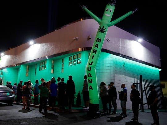 In this Saturday, July 1, 2017, photo, people line up at the NuLeaf marijuana dispensary in Las Vegas. Recreational marijuana sales have exceeded the expectations of Las Vegas area store owners.