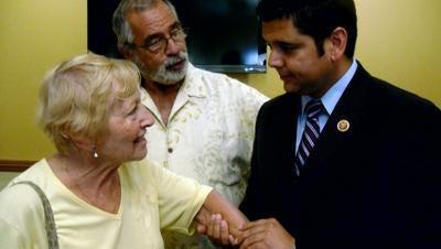Holocaust survivor Frances Nassau shows Congressman Raul Ruiz her concentration camp tattoo in this 2013 Desert Sun file photo.