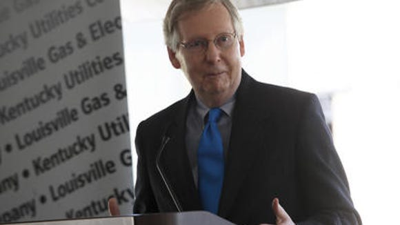 Sen. Mitch McConnell speaking at a Mill Creek power plant new conference in 2013.