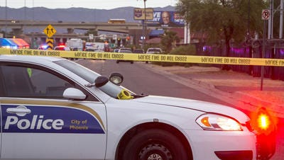 DPS officer shot after stopping car with darkly tinted windows