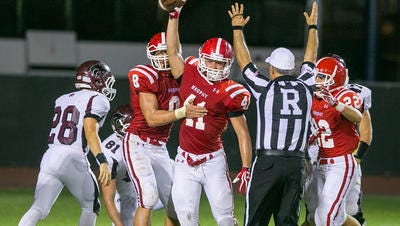 Brophy Prep junior linebacker Walker Adams celebrates a fumble recovery in a  game last season.