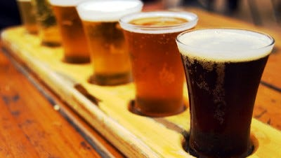 Try a beer flight at your favorite brewery.