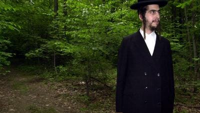 In 2005, Joel Gross of Brooklyn stands near the site where he hoped a yeshiva would be built on Hillside Avenue in Airmont. The village of Airmont was sued by the Justice Department for violating the Religious Land Use and Institutionalized Persons Act by prohibiting the construction of boarding schools; Gross filed was an individual plaintiff in the lawsuit.