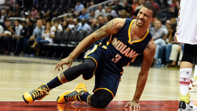 Indiana Pacers guard George Hill (3) reacts after being injured tripping over Atlanta Hawks guard Kyle Korver (not shown) during the first half at Philips Arena.