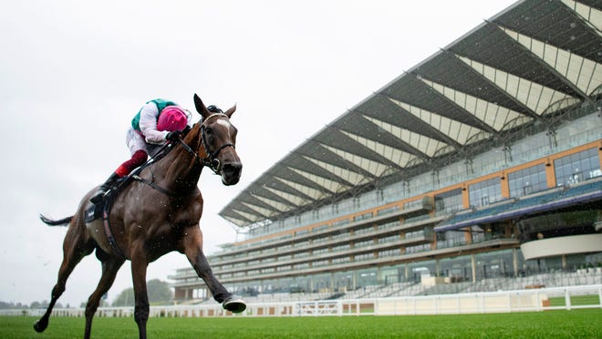 Enable ridden by jockey Frankie Dettori wins the King George VI and Queen Elizabeth QIPCO Stakes at Ascot Racecourse, England, Saturday July 25, 2020. (Edward Whitaker/PA via AP)