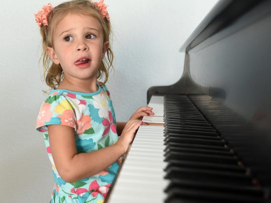 3-year-old Emmeline Orton tries to play the piano in her home in Reno on Sept. 2, 2017. A year ago OrtonÕs mother Alisa Hardy Orton was killed by a drunk driver near her home in Sommersett.  Jason Bean/Reno Gazette-Journal- USA TODAY NETWORK