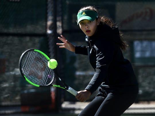 Bishop Manogue's Tara Chilton defeats Reno's Erica Schwab to win the girl's singles regional tennis championship at Bishop Manogue in Reno on Oct. 14, 2017.