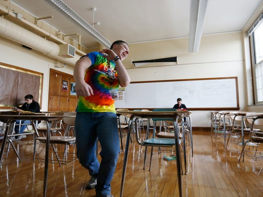 Jack Schuler celebrates as he finishes up his final first-year teacher evaluation Friday, May 20, 2016, before teaching class at Lincoln High School in Des Moines. Schuler began teaching for the district as Elyse Schuler before coming out as transgender to his students and coworkers.