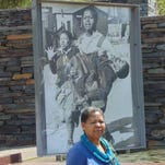 Antoinette Sithole in front of the iconic photo of herself reacting to the death of her brother, Hector Pieterson, 40 years ago in Soweto.