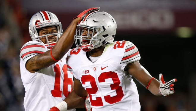 Ohio State safety Tyvis Powell (23) celebrates an interception with teammate defensive back Cam Burrows (16) during the second half of an NCAA college football game against Virginia Tech in Blacksburg, Va., Monday, Sept. 7, 2015.