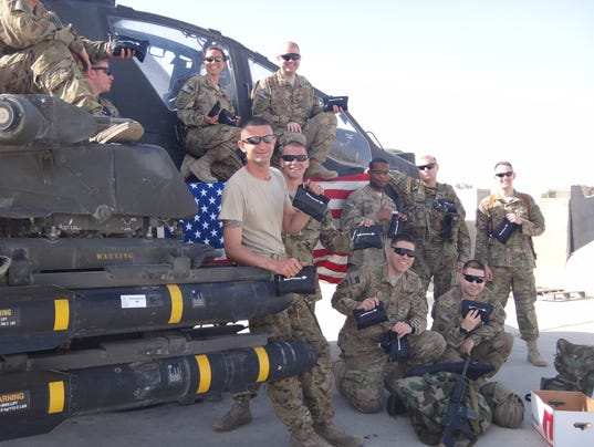 636299394365735749-Troops-with-care-packages.jpg