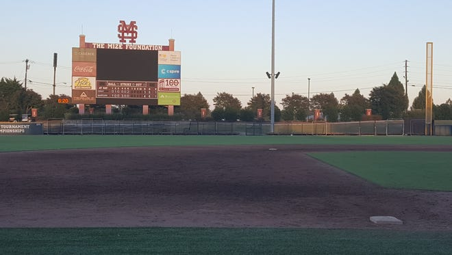 A make-shirt fence encloses right field at Dudy Noble Field.