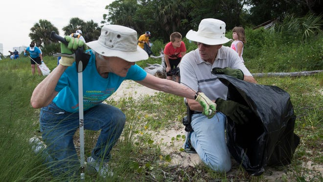 Marilyn and David Oberhausen clean up Bruce Beach on Wednesday.