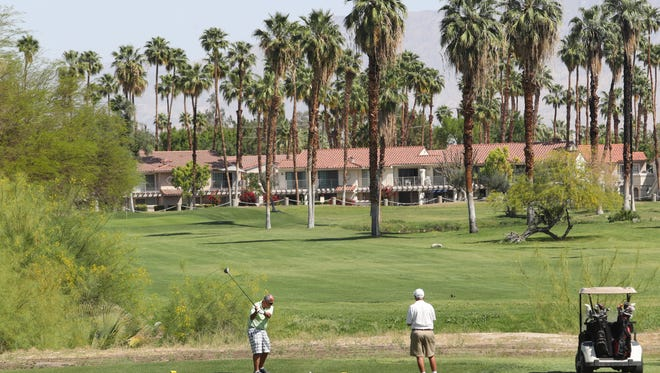 Golfers tee off on the 10th hole at Mesquite Country Club in Palm Springs, April 9, 2018.
