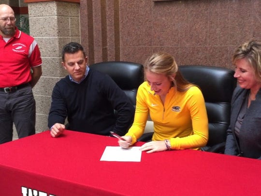 Wausau East senior Enne Burton signs a national letter