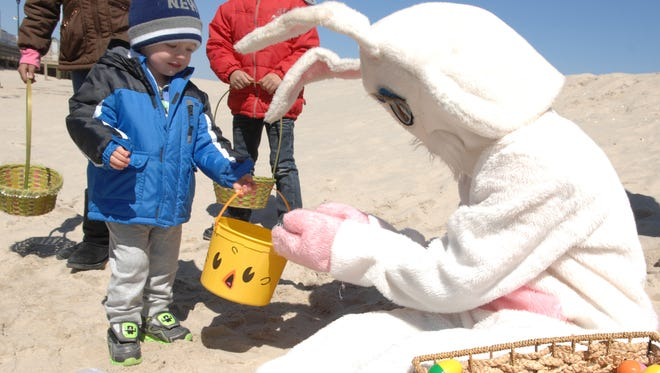 Keaton Perina, 2, of Staten Island, N. Y.,meets with the Easter Bunny at the 2015 Easter Egg Hunt on the beach in Seaside Heights.
