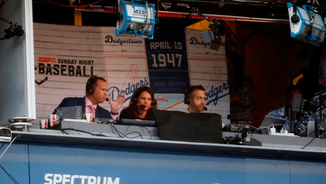 ESPN broadcaster Alex Rodriguez works from the Vin Scully Press Box during the baseball game between the Los Angeles Dodgers and San Francisco Giants.