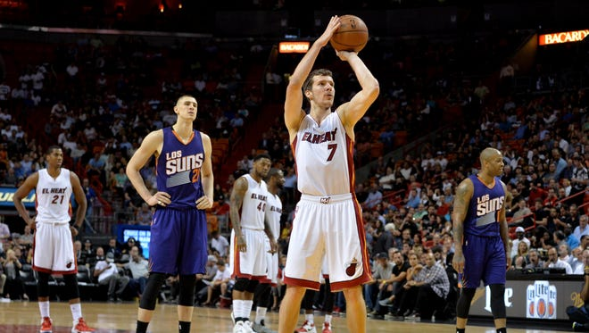Miami Heat guard Goran Dragic (7) shoots a technical shot as Phoenix Suns center Alex Len (21) looks on during the second half at American Airlines Arena.