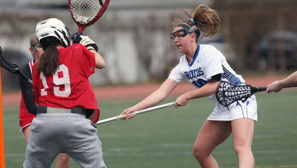 Bronxville's Allie Berkery (18) puts a shot past Fox