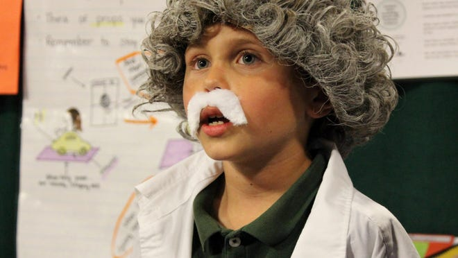 Sycamore Valley Academy first-grader Olin Brady portrays his hero Albert Einstein at TCOE's Night at the 21st Century Museum at the Visalia Convention Center Tuesday evening.
