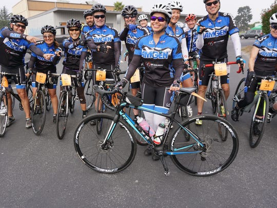 Marlin Campos, 32, of Simi Valley, is cheered on by other riders in the Arthritis Foundation's California Coast Classic Bike Tour, a 570-mile, eight-day ride from San Francisco to Los Angeles. The riders are spending Friday night in Ventura.