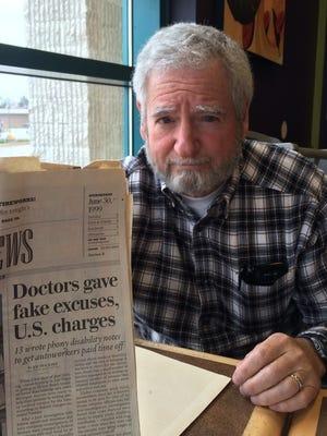 Dr. Richard Czop holds a 1999 Detroit Free Press article about his criminal charges.