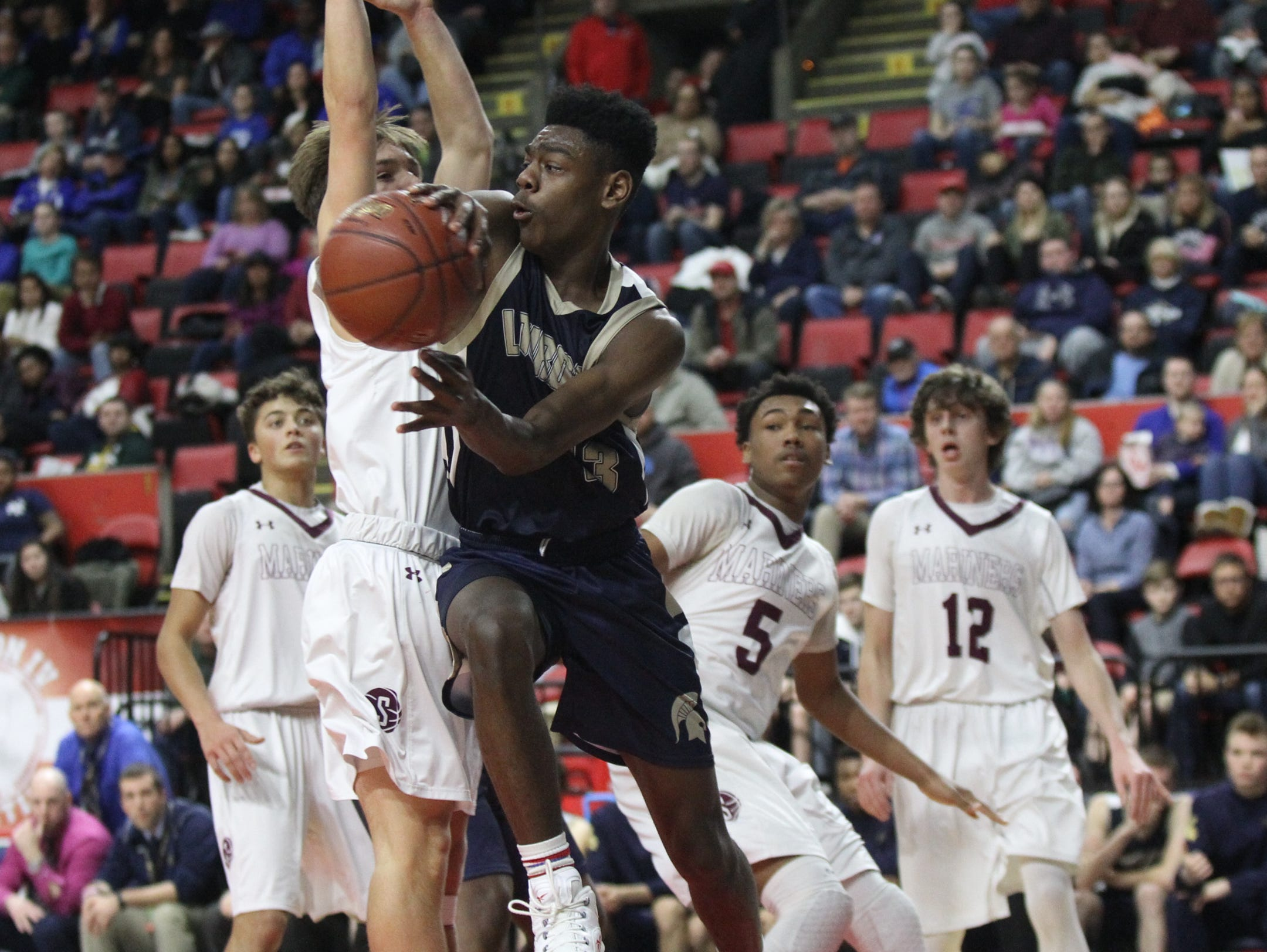 Our Lady of Lourdes's Kevin Townes (13) feeds a pass from underneath the basket during their 70-67 win over Southampton in the NYSPHSAA boys Class A semifinal basketball game at Floyd L. Maines Veterans Memorial Arena in Binghamton on Saturday, March 18, 2017.