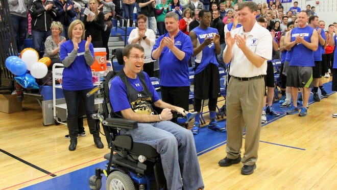 Brendan McCarthy is introduced to the crowd at the Horseheads Middle School gym during a celebrity charity basketball game in his honor on March 21 at Horseheads Middle School.