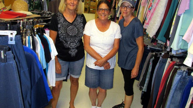 Clothes Basket volunteers, from left, Kathy Cross, Deb Clark and Carrie Clark pose in July 2019 in the Morrisville Community Church-based thrift shop. They will reopen Sept. 17 for shopping 10 a.m. to 2 p.m. Thursdays only.