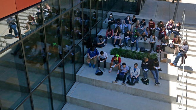 Students work outside in an outdoor classroom at Joplin High School.