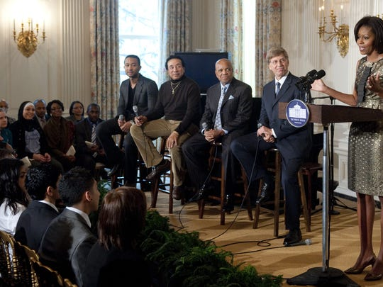 "US First Lady Michelle Obama speaks during a student workshop event, ""The Sound of Young America: The History of Motown,"" that brings students from across the country to participate in an event with Motown legends in the State Dining Room of the White House in Washington, DC, February 24, 2011. Seated alongside Obama are (L-R): Singer John Legend, singer Smokey Robinson, record producer Berry Gordy and Robert Santelli, the GRAMMY Museum's Executive Director. AFP PHOTO / Saul LOEB (Photo credit should read SAUL LOEB/AFP/Getty Images)"