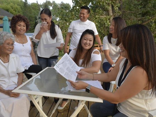 Members of Fil Am Great Falls, a Filipino-American club, finalize their upcoming event, Taste of the Philippines.