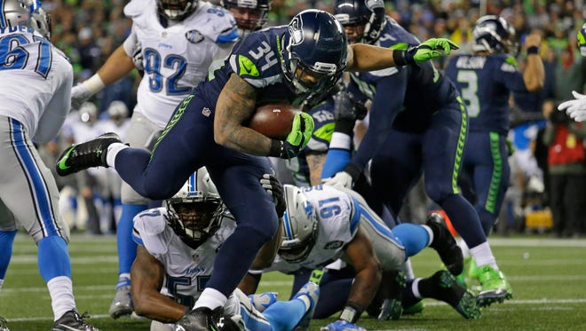 Seahawks running back Thomas Rawls (34) rushes for a touchdown against Detroit in the second half Saturday of an NFC wild-card playoff game at CenturyLink Field. The Seahawks won, 26-6.