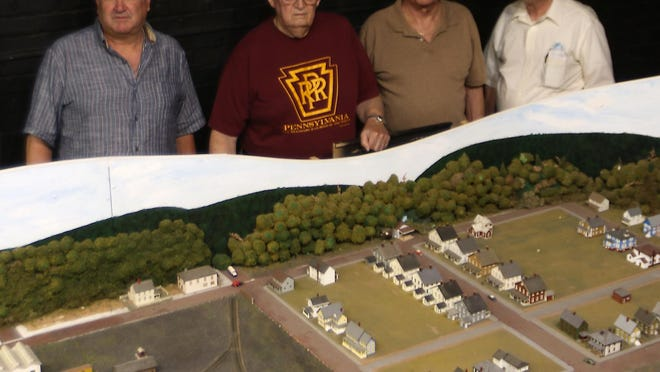 Model railroaders (L-R) Tony Daley, Charlie Dierkes, Jim Kennedy and Lars King at the model railroad set in the Dennison Railroad Depot Museum.