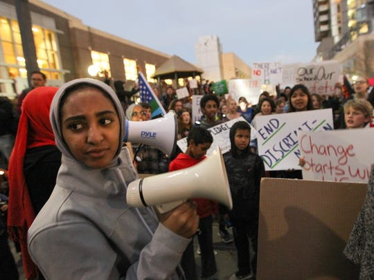 West High junior Lujayn Hamad and her friends lead hundreds of community members through Iowa City during an anti-discrimination protest on Tuesday, Nov. 15, 2016.