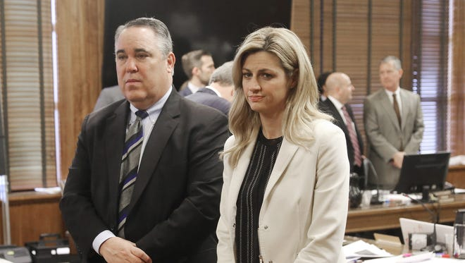 Sportscaster and television host Erin Andrews, right, stands with attorney Scott Carr as the jury enters the room during her civil trial Thursday, Feb. 25, 2016, in Nashville, Tenn. Andrews has filed a $75 million lawsuit against the franchise owner and manager of a luxury hotel and a man who admitted to making secret nude recordings of her in 2008. (Alan Poizner/The New York Post, Pool via AP)