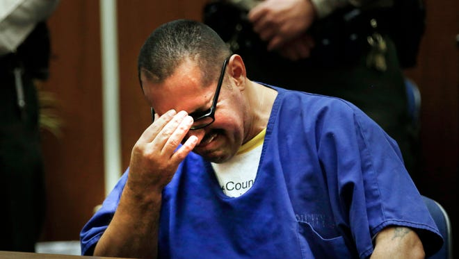 Luis Vargas, who has been in prison for 16 years, reacts in court as he is exonerated Monday, Nov. 23,  in Los Angeles. A judge exonerated Vargas, convicted of three rapes, after DNA evidence linked the crimes to a serial rapist wanted for assaults dating back two decades.