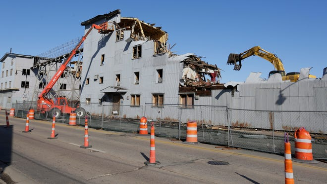 Crews raze buildings at the site of the former Buckstaff furniture factory on S. Main St. in Oshkosh to make way for a new arena for a minor league basketball team affiliated with the Milwaukee Bucks.