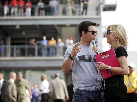 Laura Steele chats with Mark Wahlberg before the 2010 edition of the Indianapolis 500.